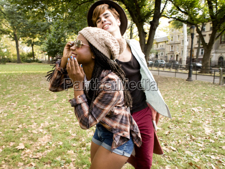 young hipster couple fooling around in