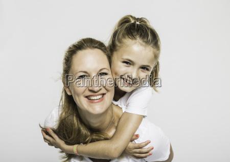 studio portrait of happy girl getting