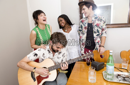 two young hipster couples in apartment