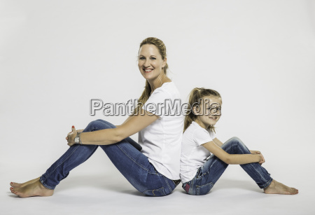 studio portrait of girl and mother