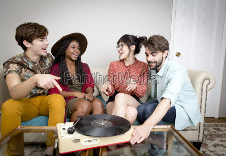 young hipster couples listening to vinyl