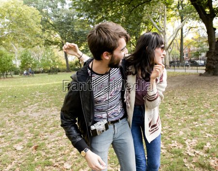 happy young hipster couple fooling around