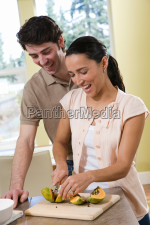 couple in kitchen cooking