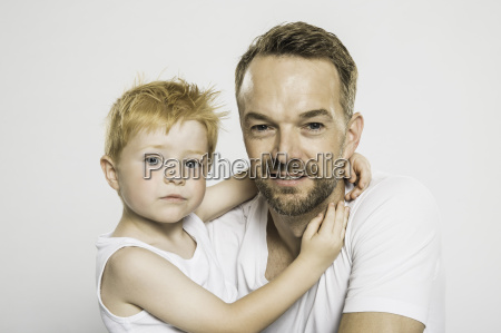 studio portrait of boy with arms