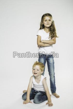 studio portrait of boy and sister