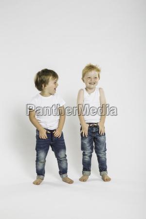 studio portrait of two cute boys