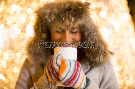 mature woman wearing furry hood and