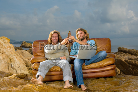 young men with laptop and beer