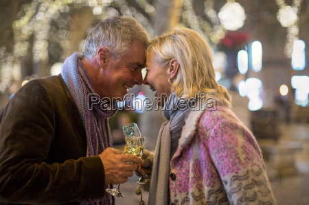 mature couple making a champagne toast