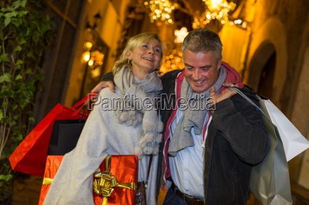 mature couple xmas shopping on street