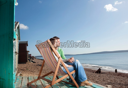 couple relaxing by the beach