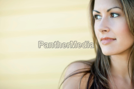 close up of woman looking off