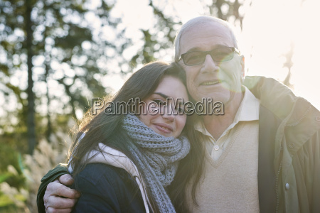 portrait of grandfather and granddaughter outdoors