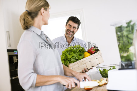 mature couple preparing food at