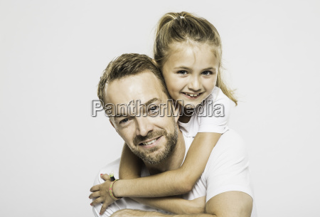 studio portrait of girl getting piggyback