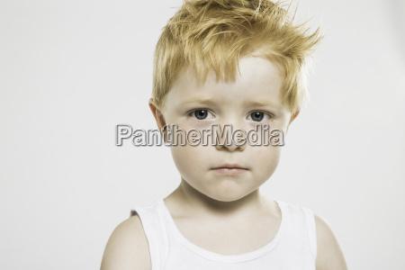 studio portrait of confident staring boy