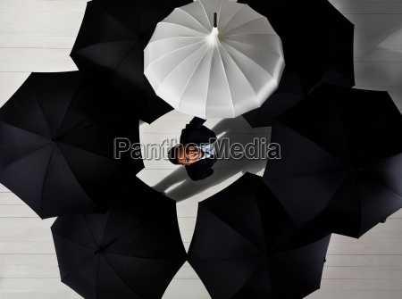 business woman with white umbrella