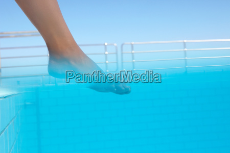 stepping into blue water