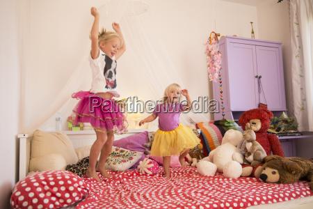 girl and toddler sister dancing in