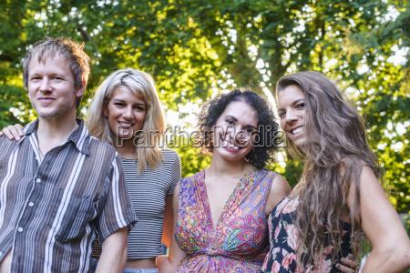 portrait of four adult friends at
