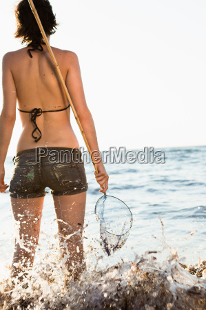 woman playing with fishing net on