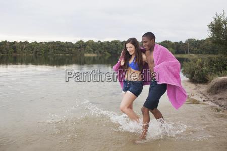 young couple enjoying lake