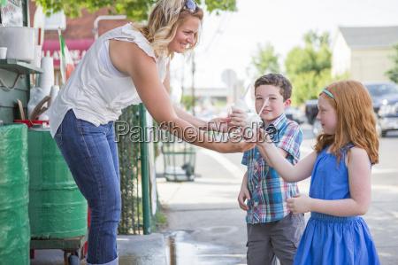 ice cream parlour shop keeper handing