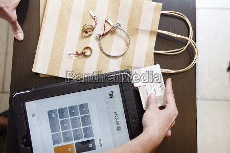 mature woman using digital tablet to