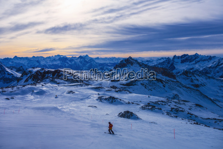 skier in mountains at dusk cervinia