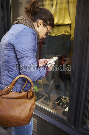 mid adult woman using smartphone at