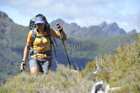 mid adult woman hiking through kahurangi
