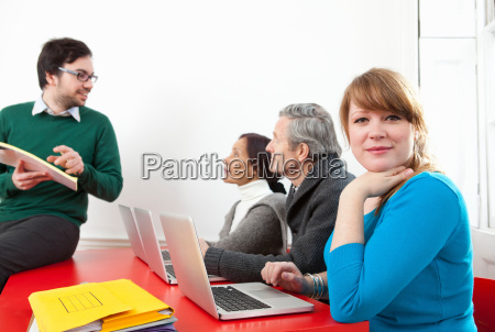 people taking computer class together