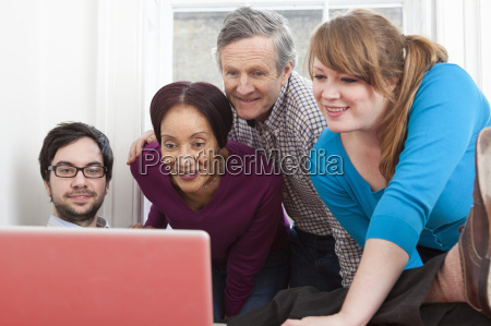 people using laptop together