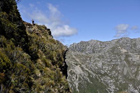 mid adult woman on mountainside hiking
