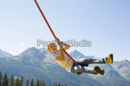 boy playing on swing tyrol austria