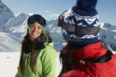 two women wearing knit hats in