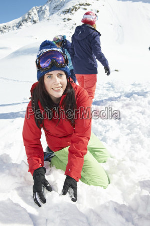woman playing in snow kuhtai