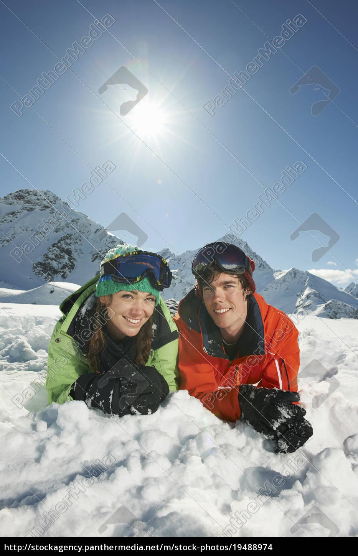 couple, lying, in, snow, , kuhtai, , austria - 19488974