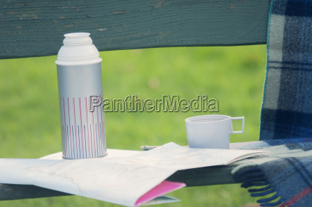 drinks flask and folding map on