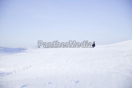 young girl walking in snowy landscape