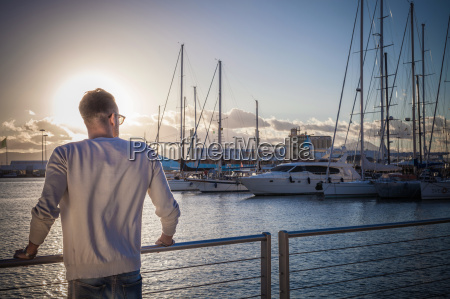 young man relaxing by port cagliari