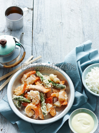 bowl of tempura seafood with rice