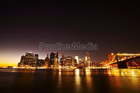 new york skyline lit up at