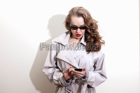 woman using cell phone indoors