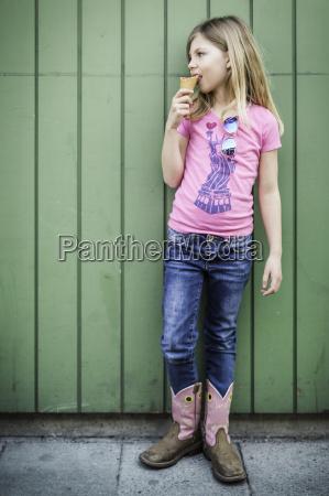 portrait of young girl eating icecream