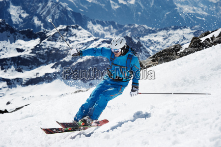 male skier speeding down mountain