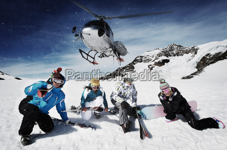 group of skiers with rescue helicopter
