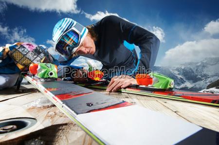male skier examining skis