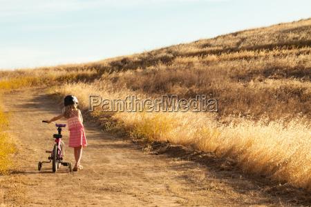 girl pushing bicycle mt diablo state