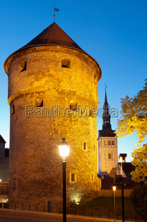 medieval city wall lit up at